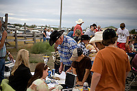 Judges compare scorecards to decide the winner at the Mechanical Bull-A-Rama at the Whoa Arena in Valier, Montana, USA.  The event, organized by Janelle Nelson, was a benefit for local youth rodeo participants and the local food bank.