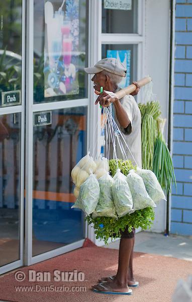 Street vendor offers vegetables for sale in Dili, Timor-Leste (East Timor)