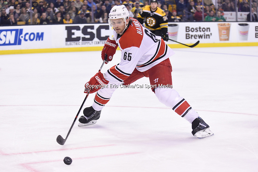 Thursday, March 10, 2016: Carolina Hurricanes defenseman Ron Hainsey (65) reaches for the puck during the National Hockey League game between the Carolina Hurricanes and the Boston Bruins held at TD Garden, in Boston, Massachusetts. Carolina beats Boston 3-2 in overtime. Eric Canha/CSM