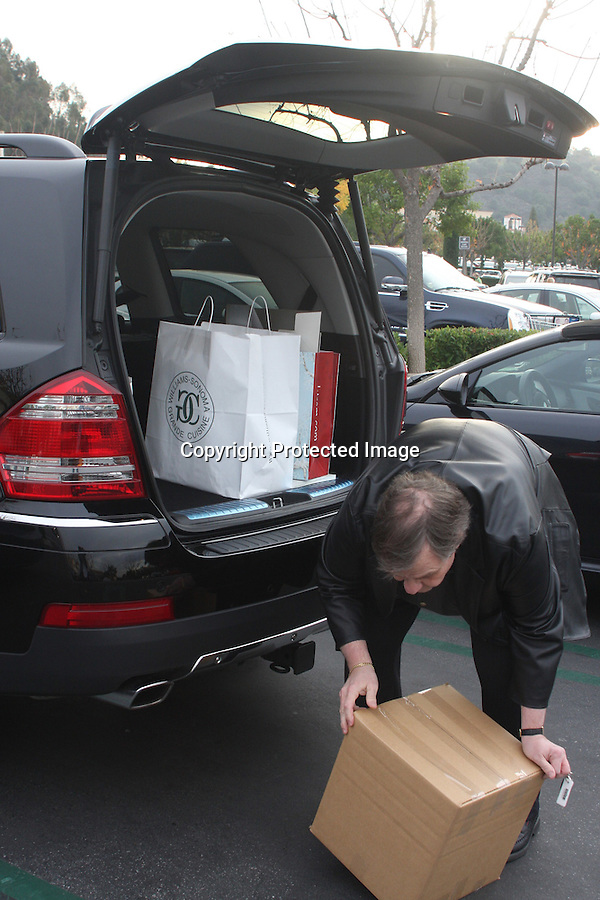 ..12-22-09.Exclusive...Meat Loaf shopping at the Commons shopping center in Calabasas California.  Meat Loaf seemed really happy & said he was buying stocking stuffers. He was lifting some big boxes into his car filled with presents. ..AbilityFilms@yahoo.com.805-427-3519.www.AbilityFilms.com.