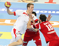 12.01.2013 Barcelona, Spain. IHF men's world championship, Quarter-Final. Picture show Henrik Toft Hansen    in action during game between Denmark vs Hungary at Palau ST Jordi