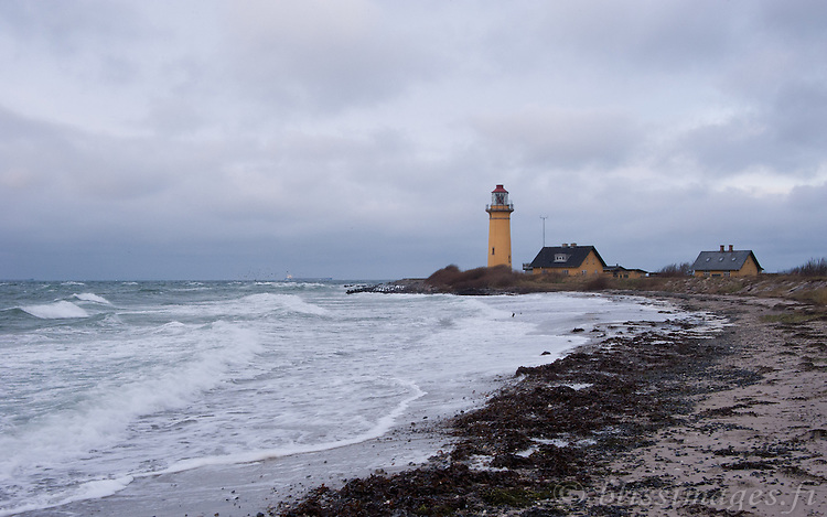 A stiff wind whips up waves and clouds at Omo Lighthouse