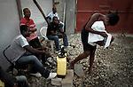 The cholera epidemic in Haiti has already killed 4.500 people and sickened more than 250.000. Antes de entrar en los centros de asistencia medica las personas son desinfectadas con cloro . Photo by Jose L. Cuesta