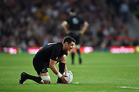 Dan Carter of New Zealand lines the ball up for a kick at the posts. Rugby World Cup Final between New Zealand and Australia on October 31, 2015 at Twickenham Stadium in London, England. Photo by: Patrick Khachfe / Onside Images