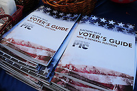 Tempe, Arizona. October 13, 2012 - Copies of an Election 2012 Voter's Guide for the November General Election were distributed to registered voters during a traditional, non-partisan political rally held in Tempe, Arizona, where hundreds of constituents attended. Candidates for the US Senate, House of Representatives, state legislature, Maricopa County and other public offices pitched for votes for the upcoming general election. Photo by Eduardo Barraza © 2012