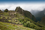 The ancient ruins of Machu Picchu in the mist, the end of the Inca Trail in Peru.