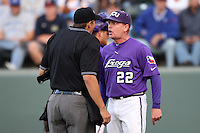 TCU Horned Frogs Head Coach Jim Schlossnagle #22 argues with home plate umpire Mark Uyl during a game against the UCLA Bruins at the Los Angeles super regionals at Jackie Robinson Stadium on June 9, 2012 in Los Angeles,California. UCLA defeated TCU 4-1.(Larry Goren/Four Seam Images)