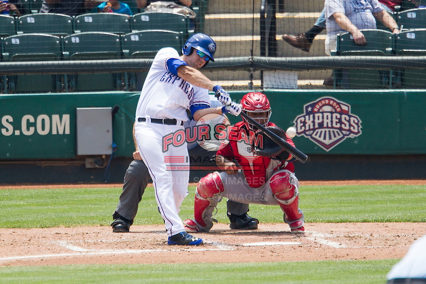 Round Rock Express first baseman Brett Nicholas #19 swings the bat during the Pacific Coast League baseball game against the Memphis Redbirds on April 27, 2014 at the Dell Diamond in Round Rock, Texas. The Express defeated the Redbirds 6-2. (Andrew Woolley/Four Seam Images)