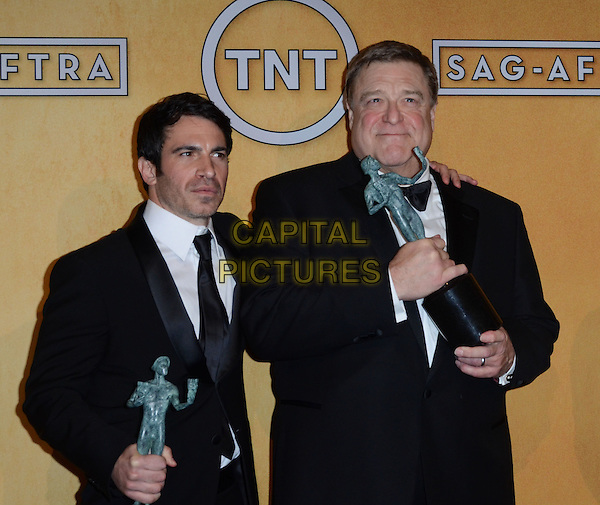 Chris Messina, John Goodman.Pressroom at the 19th Annual Screen Actors Guild Awards held at The Shrine Auditorium, Los Angeles, California, USA..27th January 2013.SAG SAGs half length black suit white suit award trophy winner trophies tuxedo winners .CAP/ADM/TW.©Tonya Wise/AdMedia/Capital Pictures.