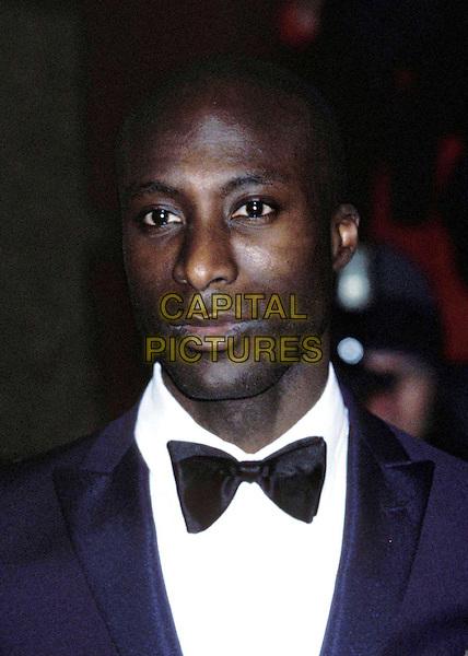 OSWALD BOTANG..Ref: 11315..bowtie, headshot, portrait..www.capitalpictures.com..sales@capitalpictures.com..©Capital Pictures..