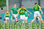 Andrew Garnett goes for a score as Mick McMahon of Limerick looks on in the Munster Junior Championship Semi final held in the Gaelic Grounds last Saturday.