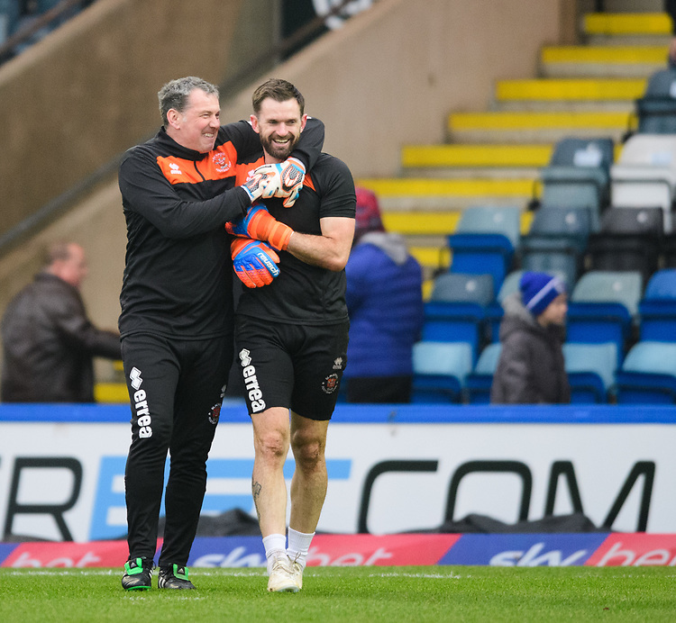 Blackpool's goalkeeping coach Dave Timmins, left, and Blackpool's Mark Howard during the pre-match warm-up<br /> <br /> Photographer Chris Vaughan/CameraSport<br /> <br /> The EFL Sky Bet League One - Rochdale v Blackpool - Wednesday 26th December 2018 - Spotland Stadium - Rochdale<br /> <br /> World Copyright © 2018 CameraSport. All rights reserved. 43 Linden Ave. Countesthorpe. Leicester. England. LE8 5PG - Tel: +44 (0) 116 277 4147 - admin@camerasport.com - www.camerasport.com