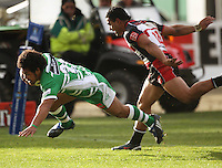 Manawatu's Tavita Taufui beats to Lelia Masaga to score during the Air NZ Cup rugby match between Manawatu Turbos and Counties-Manukau Steelers at FMG Stadium, Palmerston North, New Zealand on Sunday, 2 August 2009. Photo: Dave Lintott / lintottphoto.co.nz