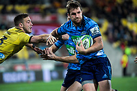 Michael Collins beats Wes Goosen during the Super Rugby match between the Hurricanes and Blues at Westpac Stadium in Wellington, New Zealand on Saturday, 7 July 2018. Photo: Dave Lintott / lintottphoto.co.nz