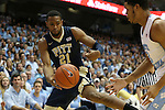 14 February 2016: Pittsburgh's Sheldon Jeter (21) tries to deflect the ball off of North Carolina's Kennedy Meeks (right) as it goes out of bounds. The University of North Carolina Tar Heels hosted the University of Pittsburgh Panthers at the Dean E. Smith Center in Chapel Hill, North Carolina in a 2015-16 NCAA Division I Men's Basketball game. UNC won the game 85-64.