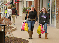 STAFF PHOTO BEN GOFF  @NWABenGoff -- 12/26/14 Cara Kirkland and daughter Kyli Bailey, 13, of Springdale shop the after-Christmas sales at Pinnacle Hills Promenade in Rogers on Friday Dec. 26, 2014.