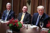 United States President Donald J. Trump, right, Acting White House Chief of Staff Mick Mulvaney, center,  and United States National Security Advisor Robert C. O'Brien, left, attend a luncheon with the Permanent Representatives of the United Nations Security Council in the Cabinet Room of the White House on December 5, 2019 in Washington, DC.<br /> Credit: Oliver Contreras / Pool via CNP
