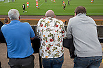 Three men watching the first half at Shielfield Park, during the Scottish League Two fixture between Berwick Rangers and East Stirlingshire (orange shirts). The home club occupied a unique position in Scottish football as they are based in Berwick-upon-Tweed, which lies a few miles inside England. Berwick won the match by 5-0, watched by a crowd of 509.