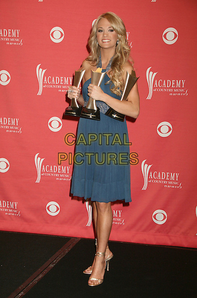 CARRIE UNDERWOOD.42nd Annual Academy Of Country Music Awards held at the MGM Grand Garden Arena, Las Vegas, Nevada, USA..May 15th, 2007.full length blue dress awards trophys gold shoes .CAP/ADM/BP.©Byron Purvis/AdMedia/Capital Pictures