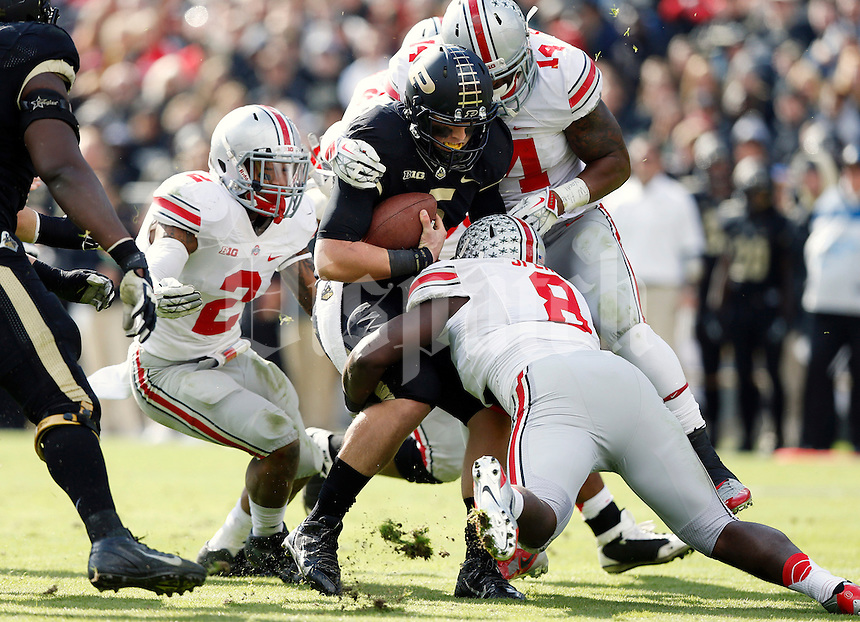 Ohio State Buckeyes defensive lineman Noah Spence (8), linebacker Curtis Grant (14) and linebacker Ryan Shazier (2) team up to sack Purdue Boilermakers quarterback Danny Etling (5) during the second quarter of the NCAA football game at Ross-Ade Stadium in West Lafayette, Ind. on Nov. 2, 2013. (Adam Cairns / The Columbus Dispatch)
