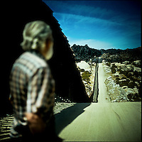 Captain Ron Hoebeck stands by the California-Mexico border fence, near Campo, Southern California. Captain Ron, a local caretaker of a few properties in the Campo area of Southern California, claims that he has been kidnapped by drug cartels more than once. Due to his living so close to the fence, illegal immigration and the fence play such an constant role in his day to day life.
