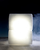 MAGNESIUM LANTERN IN DRY ICE<br /> Magnesium Burning Is An Exothermic Reaction.<br /> Magnesium is placed in a cavity in a block of dry ice. The magnesium is ignited and covered by another block of dry ice. Magnesium will take oxygen from solid carbon dioxide (CO2)  to form the remarkably stable compound, magnesium oxide.