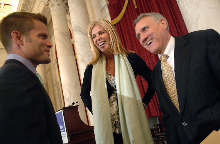 Sen. Jon Kyl, R-Ariz., right, talks with Childhelp celebrity ambassadors Casper Van Dien and Catherine Oxenberg during a luncheon held by the organization to recognize April as National Child Abuse Prevention Month.