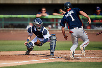 Lynchburg Hillcats catcher Logan Ice (20) attempts to tag Ian Sagdal (1) sliding home safely during the first game of a doubleheader against the Potomac Nationals on June 9, 2018 at Calvin Falwell Field in Lynchburg, Virginia.  Lynchburg defeated Potomac 5-3.  (Mike Janes/Four Seam Images)