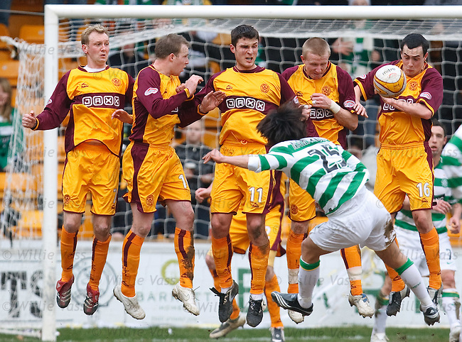 Marc Fitzpatrick uses his face to stop Shunsuke Nakamura's Free-kick