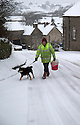 21/01/15<br /> <br /> A man walks his dog in Hartington, Derbyshire.<br /> <br /> More than 20 schools in Derbyshire were closed today following overnight snowfall that continued into the morning across the Peak District.<br /> <br /> All Rights Reserved - F Stop Press.  www.fstoppress.com. Tel: +44 (0)1335 300098