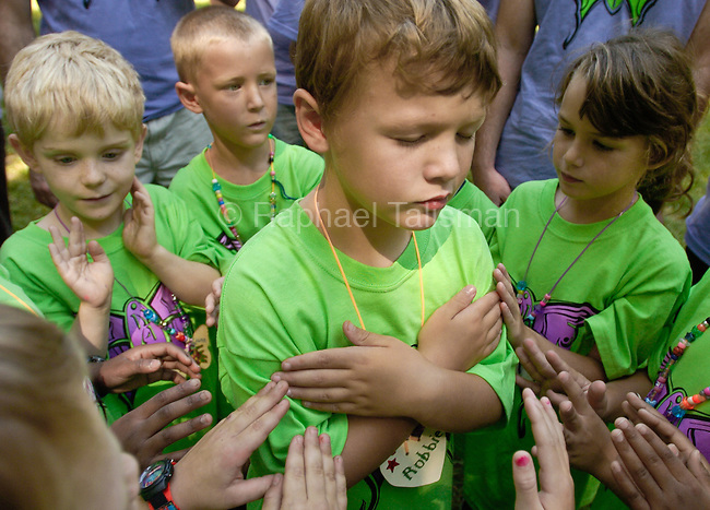 The Gazette Robert Benning, 7, of Bowie, is in the middle of a trust circle surrounded by his fellow campers who keep him upright at Camp Nabe at Arlington Echo Education Center in Millersville on Saturday.