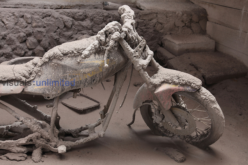 Motorbike covered in volcanic ash from Sinabung Volcano eruption, Sumatra, Indonesia