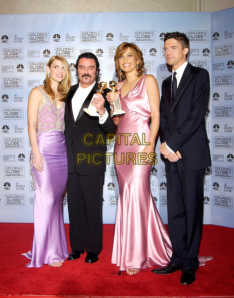 CLAIRE DANES, IAN McSHANE, MARISKA HARGITAY & TOPHER GRACE.62nd Annual Golden Globe Awards at The Beverly Hilton Hotel Hotel, Los Angeles, California. Pressroom.January 16th, 2005 .full length, award trophy, purple pink silk satin dress.www.capitalpictures.com.sales@capitalpictures.com.©Capital Pictures
