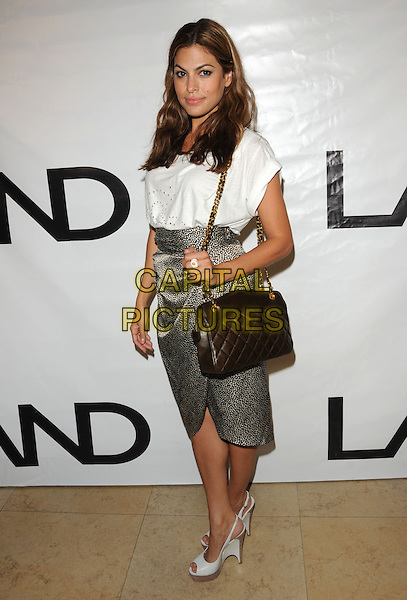 EVA MENDES.at the Los Angeles Nomadic Division 1st Annual Benefit held at The Sunset Tower Hotel in West Hollywood, California, USA, July 15th 2010                                                                               full length top t-shirt skirt chain strap brown Chanel bag quilted  cream white wedges peep toe print high waisted platform .CAP/RKE/DVS.©DVS/RockinExposures/Capital Pictures.