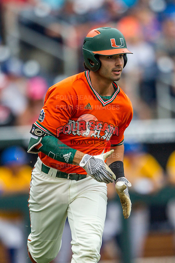 Miami Hurricanes second baseman Johnny Ruiz (4) runs to first base against the UC Santa Barbara Gauchos in Game 5 of the NCAA College World Series on June 20, 2016 at TD Ameritrade Park in Omaha, Nebraska. UC Santa Barbara defeated Miami  5-3. (Andrew Woolley/Four Seam Images)