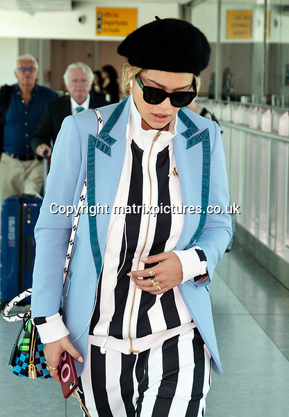 NON EXCLUSIVE PICTURE: MATRIXPICTURES.CO.UK<br /> PLEASE CREDIT ALL USES<br /> <br /> WORLD RIGHTS<br /> <br /> British singer and actress Rita Ora flies arrives at London's Heathrow Airport after flying from Los Angeles.<br /> <br /> JUNE 14th 2017<br /> <br /> REF: STD 171244