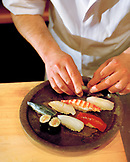 JAPAN, Kyushu, chef preparing fresh sushi served on Karatsu Pottery, Tukunda Restaurant