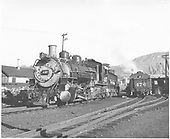 Left front view of K-37 #497 and rear end view of K-28 #476 tender.<br /> D&amp;RGW  Durango, CO  Taken by Trennert, Bob - 7/18/1967