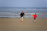 Two boys flying a kite, Popham Beach, Phippsburg, Maine, USA