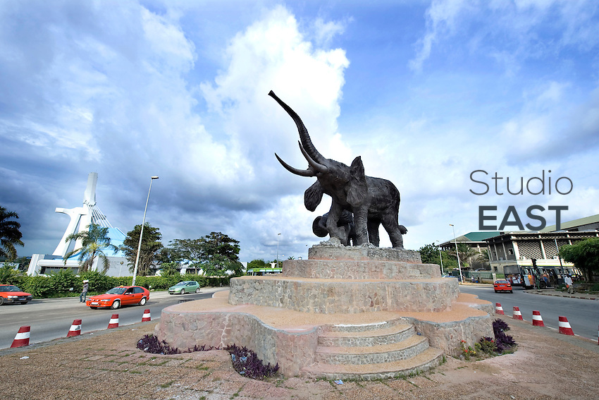 Elephants are the national animals of Ivory Coast, as proven by this statue, located on the crossings of John-Paul II avenue and Bir-Hakeim avenue, also the location of the new Saint-Paul Cathedral and the Justice hall (background), in 'Plateau' district, in Abidjan, Ivory Coast, on November 4, 2010. Photo by Lucas Schifres/Pictobank