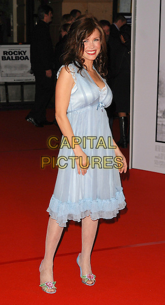 "MELINDA MESSENGER.Attending the""Rocky Balboa"" Uk Premiere,.Vue West End, London, England,.January 16th 2006..full length blue grey dress floaty flower shoes.CAP/CAN.©Can Nguyen/Capital Pictures"