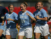OCT 2, 2005: College Park, MD, USA:  UNC Tarheels teammates #9 Kacey White, #20 Heather O'Reilly, and #17 Lori Chalupny laugh as they run to the bench before playing the Maryland Terrapins at Ludwig Field.  UNC won, 4-0. Mandatory Credit: Photo By Brad Smith (c) Copyright 2005 Brad Smith