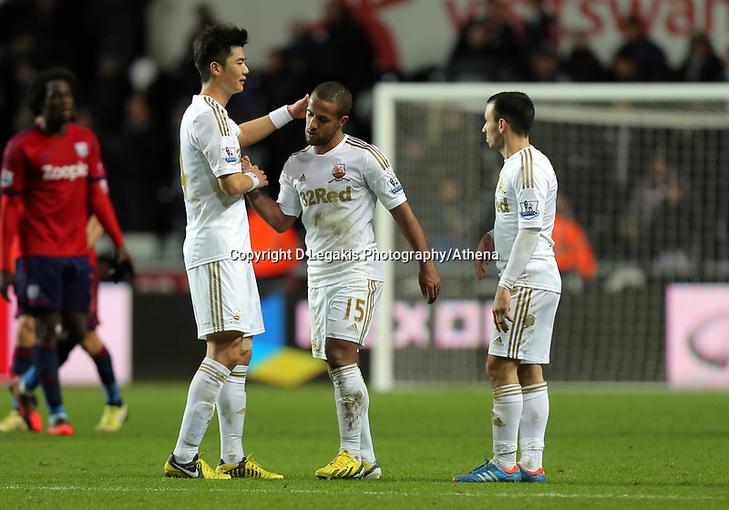 Sunday, 28 November 2012<br /> Pictured: (L-R) Ki Sung-Yueng, Wayne Routledge and Leon Britton.<br /> Re: Barclays Premier League, Swansea City FC v West Bromwich Albion at the Liberty Stadium, south Wales.