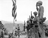 "Lt. Col. John Hopkins, commanding officer of the First Battalion, Fifth Marine Regiment, leads in singing the ""Star Spangled Banner"" during Memorial Services held in the field during the Korean campaign.  June 21, 1951. Cpl. Valle. (Marine Corps)<br /> NARA FILE #:  127-N-A9345<br /> WAR & CONFLICT BOOK #:  1401"