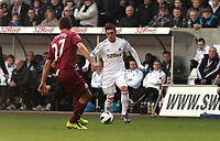 Pictured: Swansea's Pablo Hernandez runs at Steven Taylor<br />