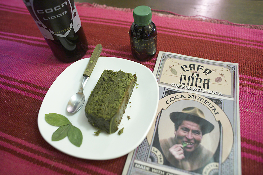 "The coca museum in La Paz, Bolivia.  Coca cake, liquor, elixir and menu with a quintu of coca leaves on the plate in the upstairs ""Coca Cafe""."