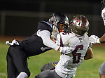 Lawndale, CA 09/29/17 - Makell Esteen (Lawndale #7) and Eric Suarez (Torrance #6) in action during the Torrance vs Lawndale CIF Varsity football game at Lawndale High School.   Lawndale defeated Torrance 42-0.