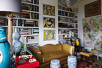The house features a series of living room, each furnished with interesting artwork and objects displayed with a collector's eye