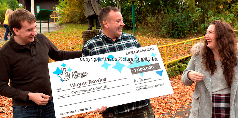 Pictured: £1million winner Wayne Rowles (C), with daughter Laura (R), and his brother Terence Rowles (L)<br /> Re: A full-time carer from Port Talbot is celebrating after winning a life-changing £1,000,000 on the EuroMillions UK Millionaire Maker.<br /> Wayne Rowles, 45, spends much of his time looking after his 82 year old father and a couple of his elderly friends. Last Friday he popped out to buy each of them a paper when he decided to try his luck on the EuroMillions.<br /> The next morning he had some rare time alone and decided to check Friday night's (21 October) EuroMillions results on his television's red button.