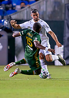 13th July 2020, Orlando, Florida, USA;  Portland Timbers defender Chris Duvall (15) jumps in with a slide tackle during the MLS Is Back Tournament between the LA Galaxy versus Portland Timbers on July 13, 2020 at the ESPN Wide World of Sports, Orlando FL.